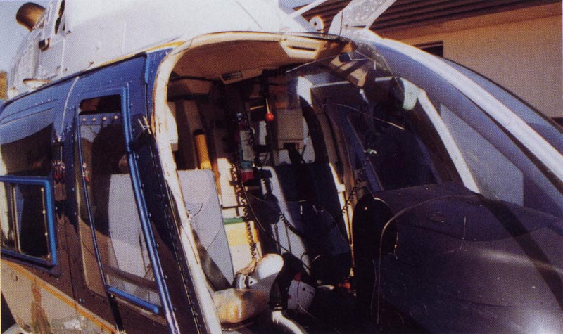13. Plate 5. An impact with a Western Grebe (3 lbs) caused considerable damage to this helicopter. The bird struck the pilot in the face. Photo courtesy Transport Canada.